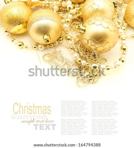 golden balls for Christmas time on white - stock photo