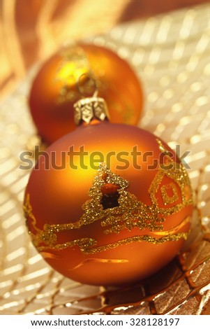 Golden baubles on golden plate