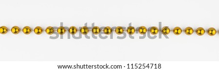 golden beads on white background - stock photo