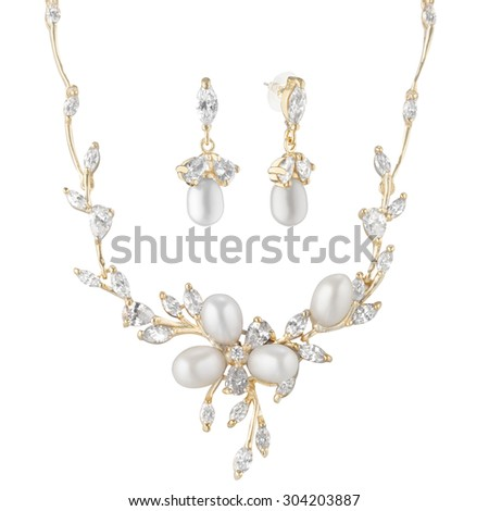 golden beautiful necklace with earrings on a white background