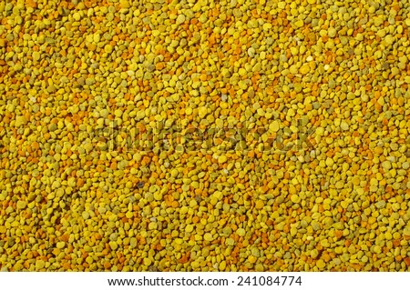 Golden bee pollen granules abstract background