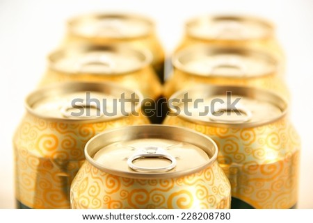 Golden beer cans. - stock photo