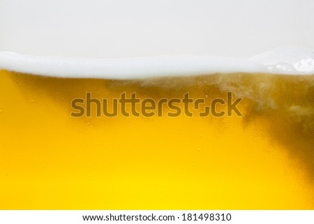 Golden Beer foam wave with bubbels