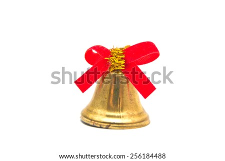 golden bell with red ribbon on white - stock photo