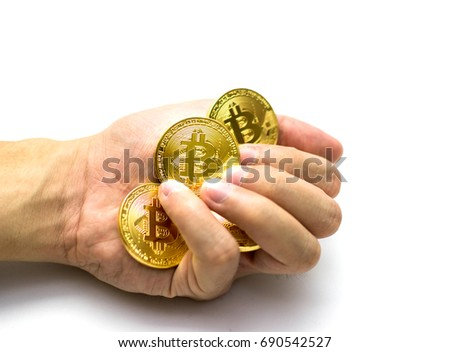 Golden Bitcoins In Hand Digital Symbol Of A New Virtual Currency On White Background