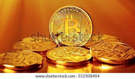 Golden Bitcoins on a gold background .Photo (new virtual money )