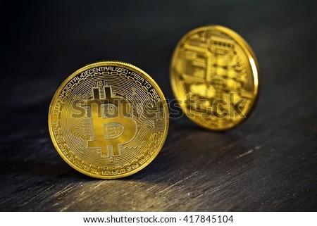 Golden Bitcoins on a wooden table .Photo (new virtual money ) - stock photo