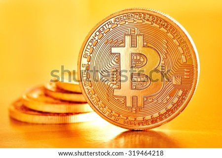 Golden Bitcoins on a yellow background .Photo (new virtual money ) - stock photo