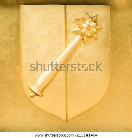 Golden Blason of Colmar, coat of arms, with mace, Alace, France - stock photo