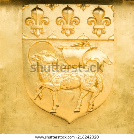 Golden Blazon of Rouen, coat of arms, with pascal lamb and  flowers of lily, France - stock photo