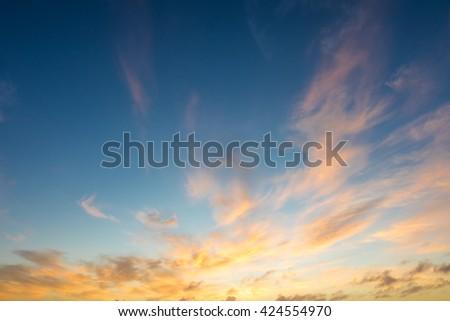 Golden blue sunrise or sunset sky - stock photo