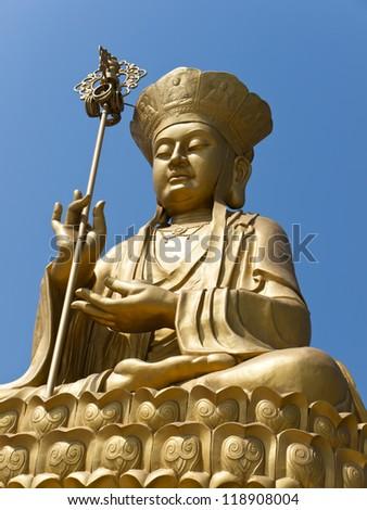 Golden Bodhisattva statue - stock photo