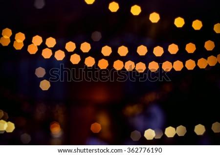 Golden bokeh lights for elegant party. - stock photo