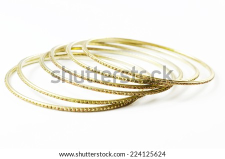 Golden bracelet isolated on white background. - stock photo