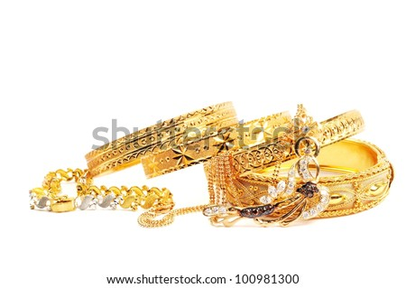 Golden bracelets and necklace with diamonds, over white - stock photo