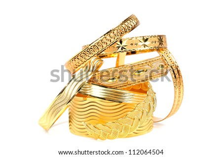 Golden bracelets ,  on a white background - stock photo