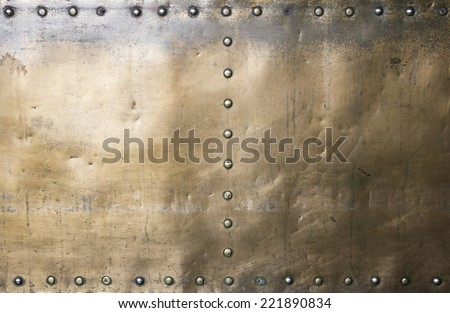Golden brass metal surface, construction and architecture - stock photo