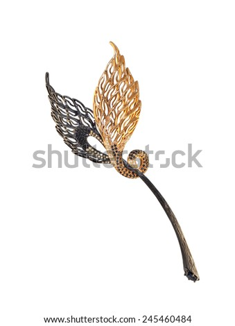 golden brooch with black and yellow diamonds on a white, black and yellow gold - stock photo