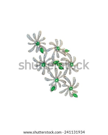 golden brooch with diamonds and emeralds - stock photo