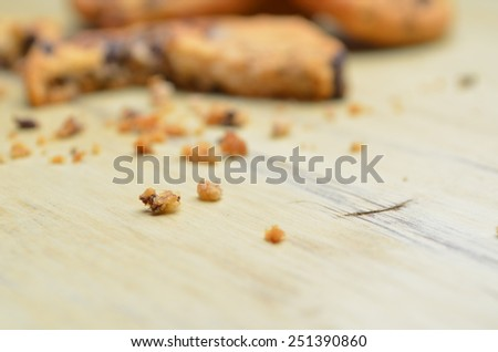 Golden brown, crumb of chocolate chip cookies over wooden table. Shallow depth of field. - stock photo