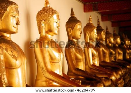 golden buddas - stock photo
