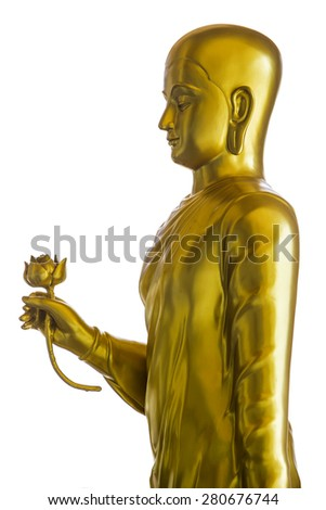 Golden Buddha handing lotus statue viewed from the side isolated.