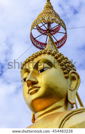 Golden Buddha head & parasol at Buddhist temple in southern Thailand - stock photo