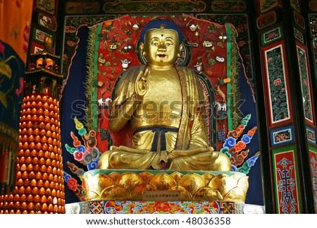 Golden buddha in temple on Mount Leshan - stock photo