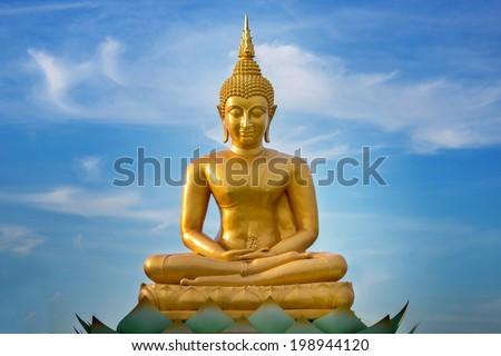 golden buddha on blue sky  - stock photo