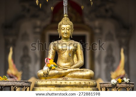 Golden buddha on front of Chiang Mai temple Sonkran festival. Thailand. - stock photo