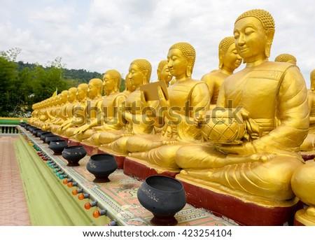 Golden Buddha on nature background at buddha memorial park , thailand - stock photo
