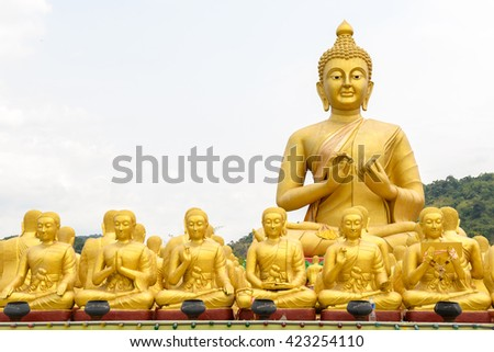 Golden Buddha on nature background at buddha memorial park , thailand