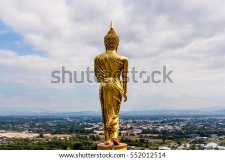 Golden buddha statue in Khao Noi temple, Nan Province, Thailand