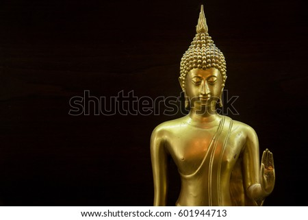 Golden buddha statue isolated on black background,statue in Buddhist Thailand temple or wat, are public domain or treasure of Buddhism
