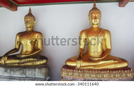 Golden Buddha Statues Inside The Temple of the Reclining Buddha in Bangkok Thailand