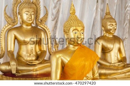 Golden Buddhist statues and carving showing intricate details and textures created by Buddhist monks Asia