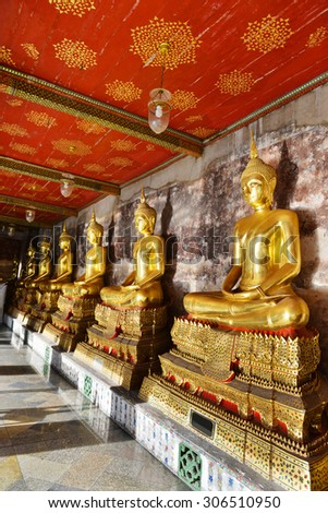 Golden Buddhist statues at Wat Suthat Temple in Bangkok, thailand - stock photo