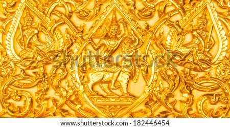 Golden buddhist temple wall in Thailand. - stock photo