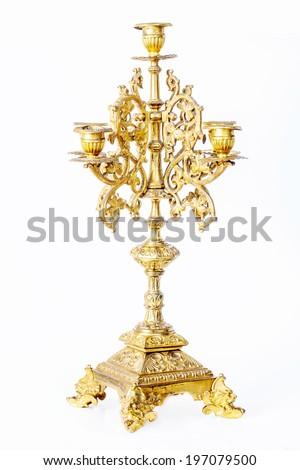 golden candlestick isolated on white background. - stock photo