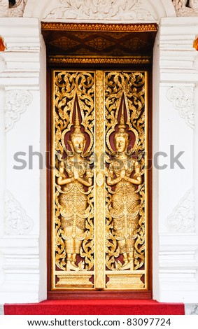Golden carvings door of the church inside the temple,Thailand