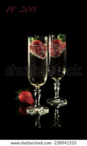 Golden champagne with strawberries and PF 2015 - stock photo