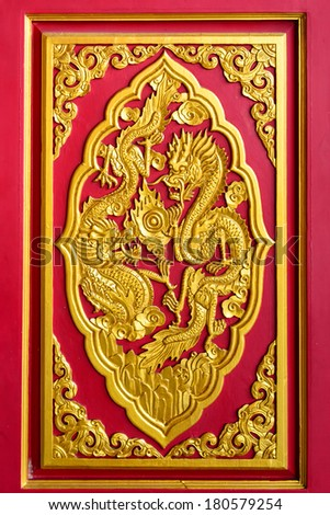 Golden chinese dragon pattern on a temple's door