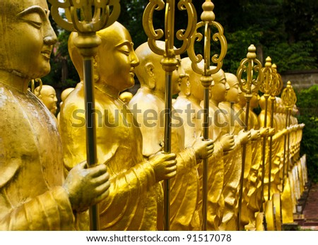 Golden Chinese style monk - stock photo