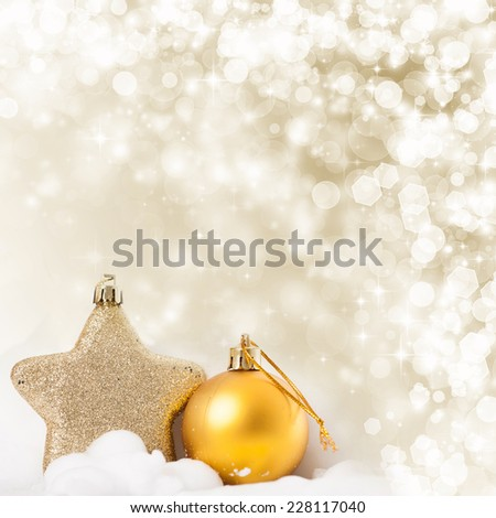 Golden Christmas background with Christmas ball and star - stock photo