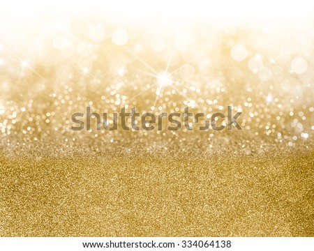 Golden Christmas background with graduated bands of different sparkling and twinkling bokeh from party lights and glitter, full frame copy space for your seasonal greeting - stock photo