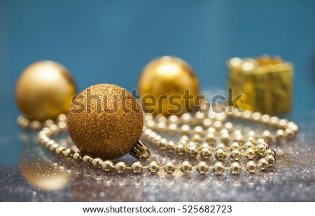Golden Christmas ball and decoration on blue background. Magic holiday lights. Merry Christmas and a Happy New Year