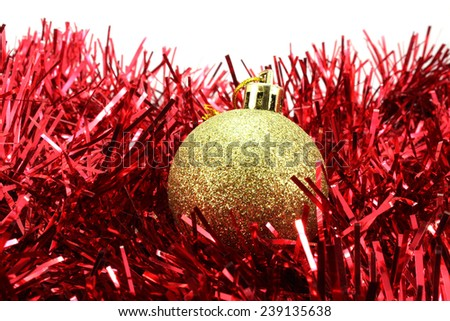 Golden Christmas ball in sequins on the red tinsel - stock photo
