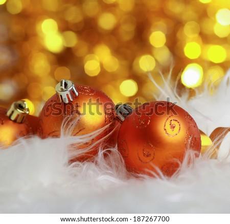 golden christmas ball on a furry background, christmas balls - stock photo