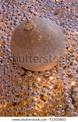 golden Christmas ball on the bright pearls - stock photo