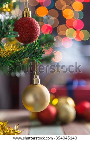 Golden christmas ball with bokeh background - stock photo